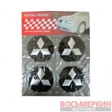 Эмблемы металлические на колпаки Mitsubishi цена за 4 шт
